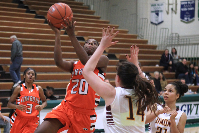 Chaparral guard Marcia Hawkins drives to the basket while being defended by Dimond of Anchorage, Alaska center Lexi Wingert during their game at the Gator Winter Classic tournament Wednesday, Dec. ...