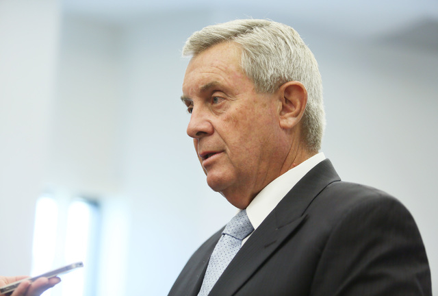 Nevada Supreme Court Justice James W. Hardesty speaks to a member of the media during a campaign to launch an effort to pass Question 1 at Sahara West Library Tuesday, Aug. 12, 2014, in Las Vegas. ...