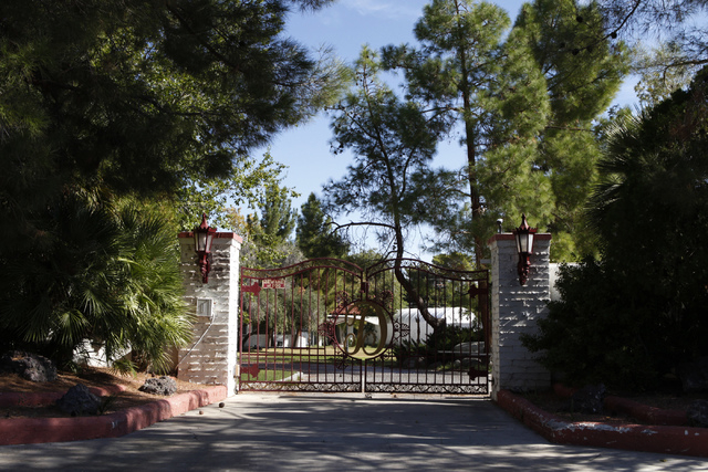 The gate to a home inside the Rancho Circle community in Las Vegas is seen on Sunday, Sept. 28, 2014. The private community has been populated by rich and famous people for most of its history. (E ...
