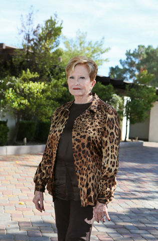 Nancy Houssels stands outside her home Friday, Oct. 10, 2014, in Las Vegas. Houssels lives in Rancho Circle gated community in a home that was built in 1965. (Ronda Churchill/Las Vegas Review-Journal)