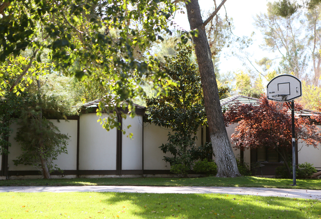 A basketball hoop can be seen outside a home in Rancho Circle gated community Friday, Oct. 10, 2014, in Las Vegas. Rancho Circle is one of the city's earliest luxury neighborhoods was home to many ...