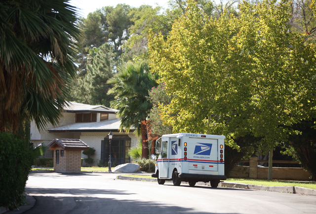 A postal truck drives through Rancho Circle gated community Friday, Oct. 10, 2014, in Las Vegas. Rancho Circle is one of the city's earliest luxury neighborhoods was home to many celebrities. (Ron ...