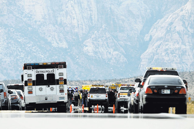 Various law enforcement agencies are on the scene of a fatal officer-involved shooting on Feb. 14, 2014, on State Route 159 in the Red Rock National Conservation Area, just west of Las Vegas. (Joh ...
