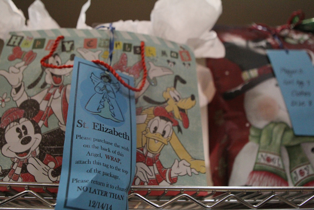 Gift wrapped Christmas gifts wait to be delivered to families as part of the Angel Tree program at St. Elizabeth Ann Seton Catholic Church in Las Vegas Sunday, Dec. 14, 2015. The program encourage ...
