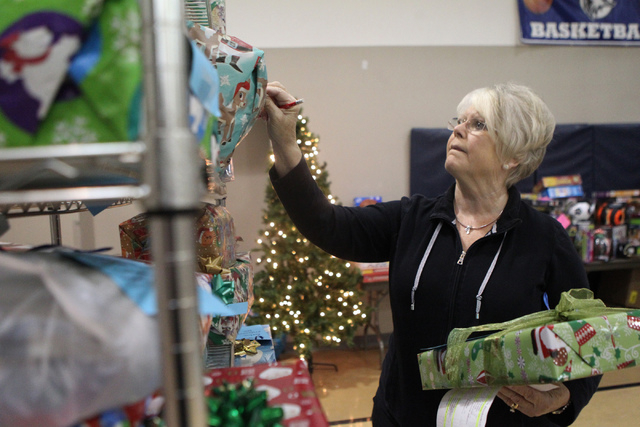 Outreach coordinator Jeanne Kilduff looks for a Christmas gift as part of the Angel Tree program at St. Elizabeth Ann Seton Catholic Church in Las Vegas Sunday, Dec. 14, 2015. The program encourag ...