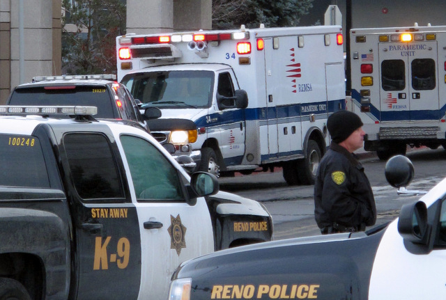 Police cruisers close off the streets in front of the Center for Advanced Medicine on the campus of Renown Regional Medical Center in Reno on Tuesday, Dec. 17, 2013. A suicidal gunman killed one p ...