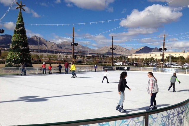 Ice skaters enjoy a sunny day at Downtown Summerlin's Rock Rink on Saturday afternoon. (Greg Haas/Las Vegas Review-Journal)
