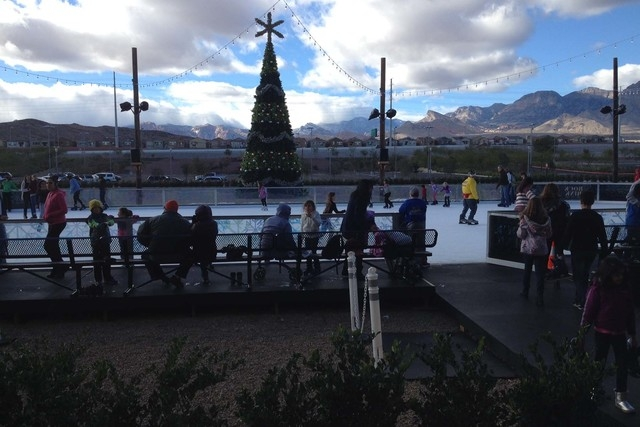 Clouds close in as ice skaters enjoy the day at Downtown Summerlin's Rock Rink on Saturday afternoon. (Greg Haas/Las Vegas Review-Journal)