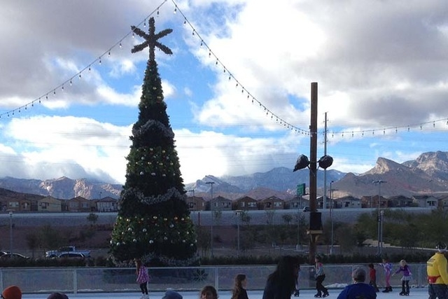 A dusting of snow is visible on the Spring Mountains in the background as ice skaters hit Downtown Summerlin's Rock Rink on Saturday afternoon. (Greg Haas/Las Vegas Review-Journal)