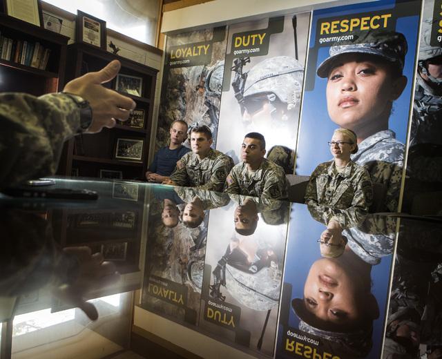University of Nevada, Las Vegas ROTC cadets from left Capt. David Watters, Sgt. Maj. Anthony Lombino, Capt. Keishmer Cardoso, 2nd Lt. Kimberly Threlkeld talk about  holiday adoption program during ...
