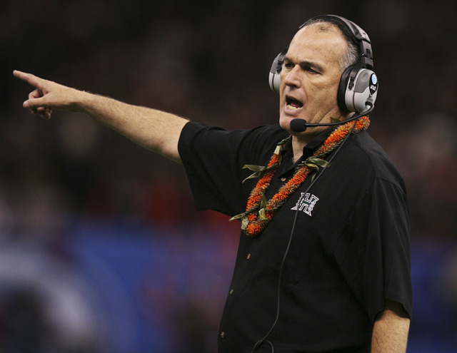 University of Hawaii Warriors head coach June Jones instructs players against the Georgia Bulldogs in the second quarter of the 74th Annual Sugar Bowl NCAA football game at the Louisiana Superdome ...