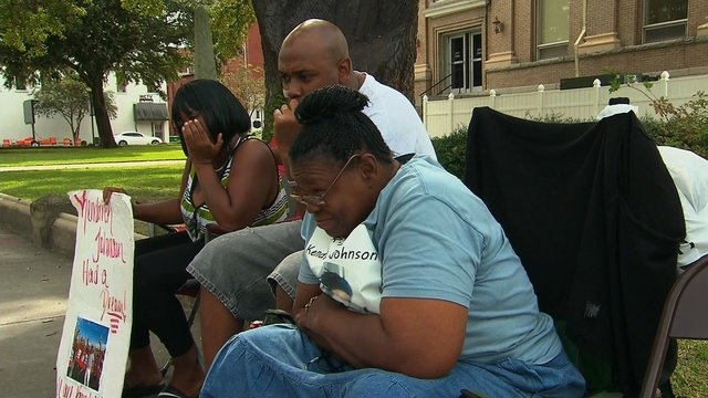 Shown: The family of the late Kendrick Johnson sits vigil outside the courthouse in Valdosta, Georgia. Nearly 10 months after their son died, the parents of Kendrick Johnson are finally getting wh ...