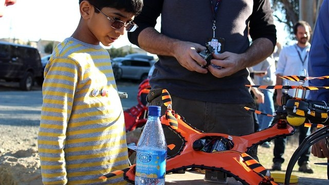 A young drone fan checks out the Game of Drones damage-resistant flying vehicle, which can withstand paintball hits, shotgun blasts and baseball bats. (CNN File)