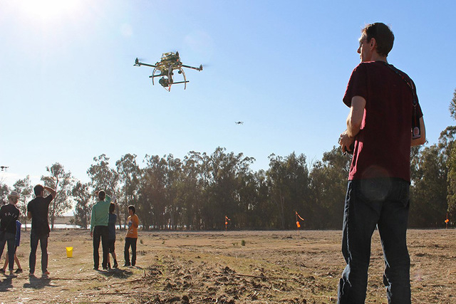 An enthusiast takes a drone, outfitted with a camera, for a spin in the test flight area. Aerial photography is one of the most popular uses for smaller consumer drones. (CNN File)