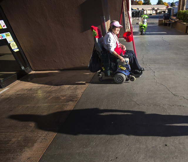Salvation Army Henderson Corps bell ringer Patricia Adler, 73, sits in front of Smith's Food & Drug Center in Henderson  on Tuesday, Dec. 9,2014. (Jeff Scheid/Las Vegas Review-Journal)