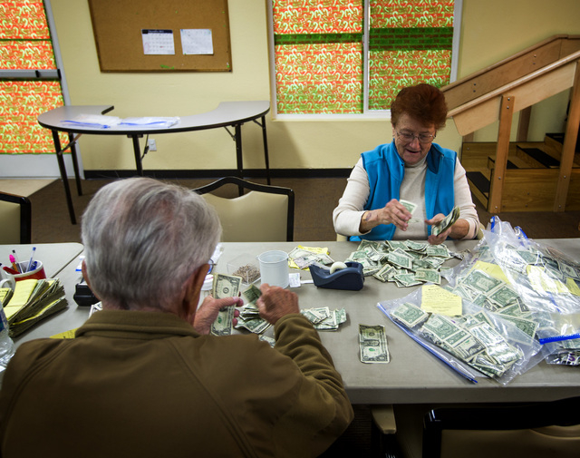 Roger Campbell, left, and Barbara Jager counts donations at the Salvation Army Henderson Corps, 830 E. Lake Mead Drive,  on Tuesday, Dec. 9,2014. (Jeff Scheid/Las Vegas Review-Journal)