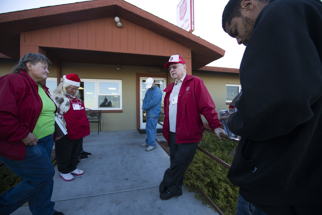 Jim Reid, second from right, kettle coordinator of the Salvation Army Henderson Corps, 830 E. Lake Mead Drive, conducts a morning prayer with bell ringers on Tuesday, Dec. 9,2014. (Jeff Scheid/Las ...