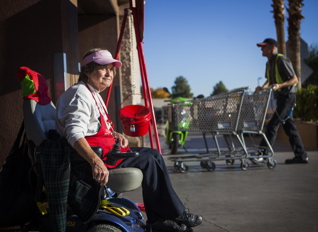 Salvation Army Henderson Corps bell ringer Patricia Adler, 73, sits in front of Smith's Food & Drug Center in Henderson  on Tuesday, Dec. 9, 2014. (Jeff Scheid/Las Vegas Review-Journal)