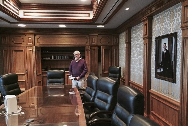 Sam Lionel spends a poignant moment in the Lionel Sawyer & Collins conference room on New Year's Eve as the law firm he founded in 1967 with former Gov. Grant Sawyer closes its doors. Sawyer's pho ...