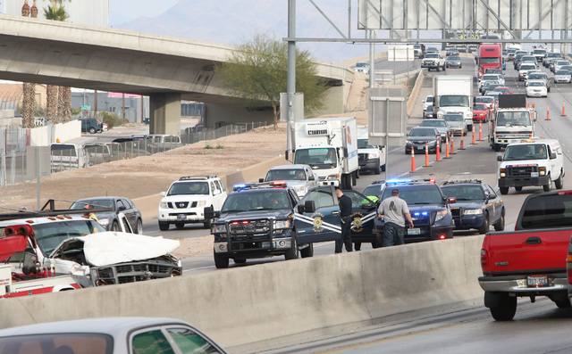 Crash has blocked all northbound lanes of U.S. Highway 95 at the Spaghetti Bowl Friday, Dec. 5, 2014. Nevada Highway Patrol responded about 12:45 p.m. Friday to a three-vehicle crash on the U.S. 9 ...