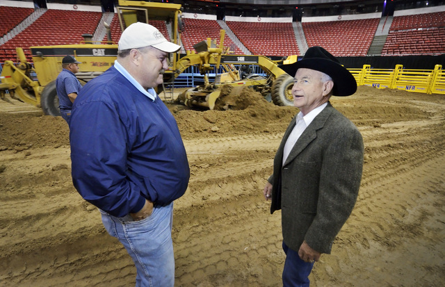 Shawn Davis, general manager of the National Finals Rodeo, right, talks with construction maintenance manager Allen Rheinheimer during preparations for the rodeo at the Thomas & Mack Center at 450 ...
