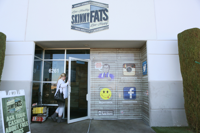 A customer enters SkinnyFATS Saturday, Dec. 6, 2014, in Las Vegas. SkinnyFATS, located at 6261 Dean Martin Drive, features a split menu that has both healthy and indulgent menu items. (Ronda Churc ...