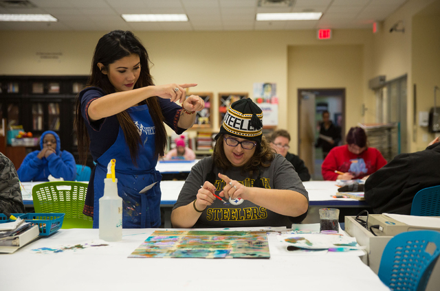 Jesi Lee, left, a mentor at Opportunity Village, helps client Kimberly B. (last name withheld) create a watercolor painting at Opportunity Village's Engelstad Campus Dec. 4, 2014. (Samantha Clemen ...