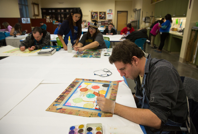 Brent C. (last name withheld), a client at Opportunity Village, creates a painting at Opportunity Village's Engelstad Campus Dec. 4, 2014. (Samantha Clemens-Kerbs/View)
