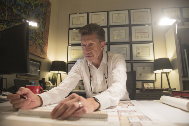 Edward A. Vance, Founder and CEO of Ed Vance and Associates, works at his desk in his office in Las Vegas on Friday, December 19, 2014. Ed Vance and Associates offers holiday bonuses, holiday part ...