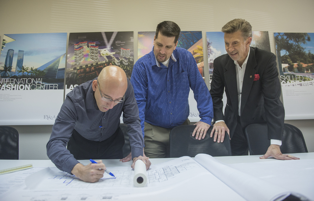 Ed Vance and Associates employees, from left, Tim Hollenbeck, project manager, Matt Burns, vice president, and Edward A. Vance, founder and CEO, look over plans at their office in Las Vegas on Fri ...
