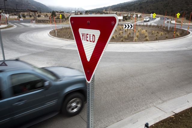 A vehicle enter the roundabout on Route 157 near the National Forest Service visitors center and picnic area , Friday, Dec. 04, 2014. The redesign road is causing challenges for some drivers.(Jeff ...