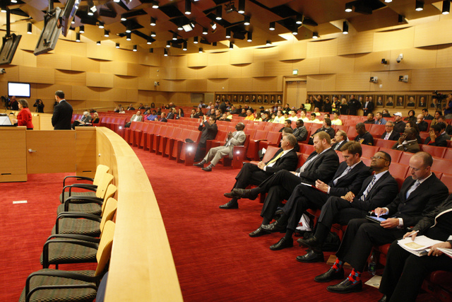 People listen to a presentation at a Las Vegas City Council meeting before a vote for a proposed soccer stadium at Las Vegas City Hall Council Chambers Wednesday, Dec. 17, 2014. (Erik Verduzco/Las ...