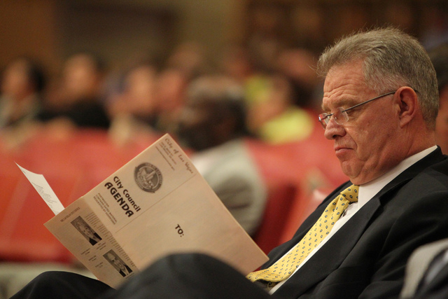 Dean Howes, a soccer stadium advisor, reads the agenda during a Las Vegas City Council meeting before a vote for a proposed soccer stadium at Las Vegas City Hall Council Chambers Wednesday, Dec. 1 ...
