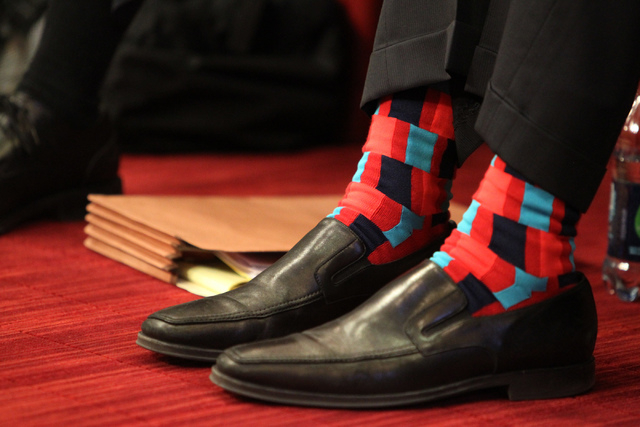 Justin Findlay, managing partner of Findlay Sports and Entertainment, wears a pair of colorful socks during a Las Vegas City Council meeting before a vote for a proposed soccer stadium at Las Vega ...