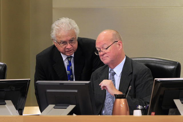 Councilmen Bob Coffin, left, and Bob Beers confer as a vote approaches on a proposed soccer stadium during a Las Vegas City Council meeting Wednesday, Oct. 1, 2014. (Sam Morris/Las Vegas Review-Jo ...
