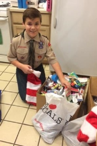 Phillip Bouchard, 13, of Las Vegas, shows some of the items he collected for the Ronald McDonald House Charities of Greater Las Vegas. (Courtesy/Ronald McDonald House Charities of Greater Las Vegas)