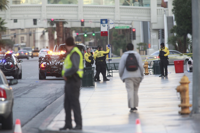 Las Vegas police investigate the scene of a shooting involving a Regional Transportation Commission security officer and man, pronounced dead at the scene, who was asked to get off of an RTC bus b ...