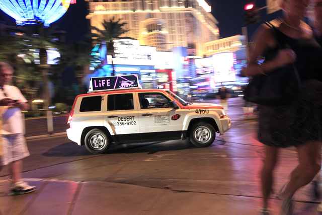 A taxi from Desert Cab is seen on the Strip Oct. 22, 2014. The taxi rate increases approved by the Nevada Taxicab Authority in October have been implemented. (Sam Morris/Las Vegas Review-Journal)