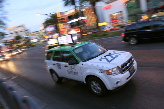 A taxi from Star Cab makes its way along the Strip Wednesday, Oct. 22, 2014. (Sam Morris/Las Vegas Review-Journal)