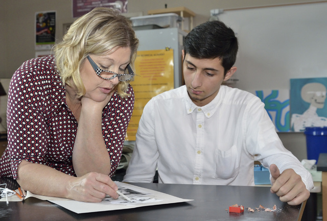 Teacher Lisa Hinricksen, left, works with Michael Garcia during an advanced drawing class at West Career and Technical Academy at 11945 W. Charleston Blvd. in Las Vegas on Thursday, Dec. 18, 2014. ...