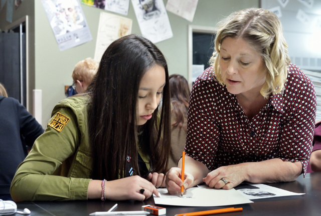 Teacher Lisa Hinricksen, right, works with Michelle Herrera during an advanced drawing class at West Career and Technical Academy at 11945 W. Charleston Blvd. in Las Vegas on Thursday, Dec. 18, 20 ...
