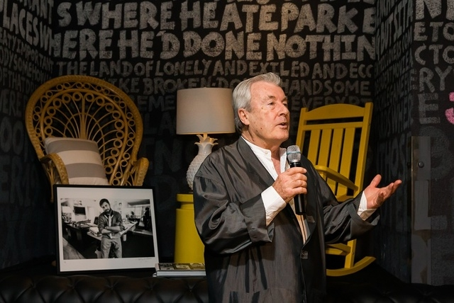 Photographer Terry O'Neill speaks to guests at a party following the official opening of SLS Las Vegas' Iconic Images gallery. (Courtesy)
