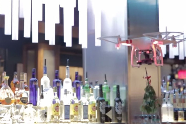 "A photographer taking pictures of a ""mobile mistletoe"" designed to encourage holiday kisses at a TGI Fridays restaurant in Brooklyn is recovering after being clipped on the nose by the drone.  ..."