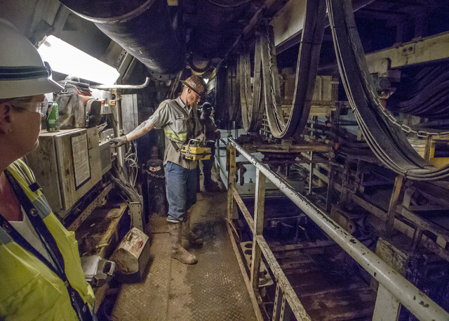 "A Vegas Tunnel Constructors ""shifter"" operates a remote control device that moves concrete tunnel sections into place behind the boring machine during construction of the third intake tu ..."