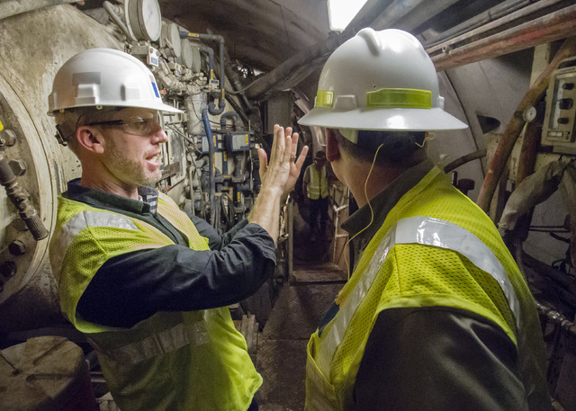 Bronson Mack, left, public information officer for Southern Nevada Water Authority, describes the tunnel bore machine during a tour of the third intake tunneling project at Lake Mead Tuesday Sept. ...