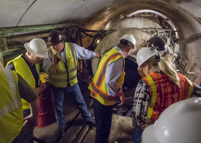 John Entsminger, left, general manager of the Southern Nevada Water Authority, and Jim Nickerson, second from left, project manager for Vegas Tunnel Constructors, with visitors at the tunnel bore  ...