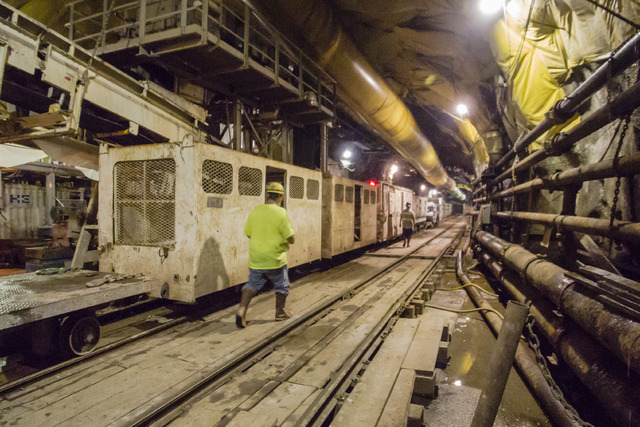 Workers walk toward the train that ferries them to and from the bore drill in the third intake tunneling project at Lake Mead Tuesday Sept. 16, 2014. (Mark Damon/Las Vegas Review-Journal)