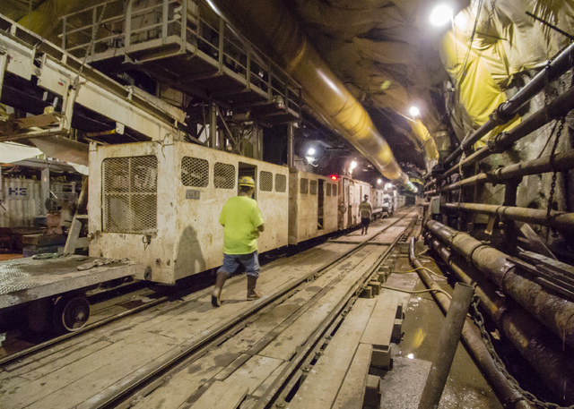 Workers walk toward the train that ferries them to and from the bore drill in the third intake tunneling project at Lake Mead Tuesday Sept. 16, 2014.  Intake No. 3, as it is officially known, is t ...