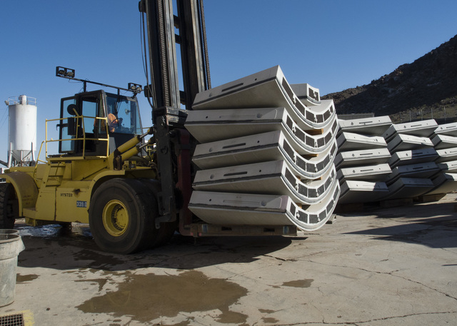 A payloader moves custom-fabricated concrete tunnel sections into place on the surface above the third intake tunneling project at Lake Mead Tuesday Sept. 16, 2014.  Intake No. 3, as it is officia ...
