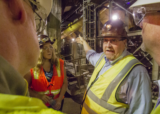 Jim Nickerson, second from right, Project Manager for Vegas Tunnel Constructors describes the project during a tour of the third intake tunnel at Lake Mead Tuesday Sept. 16, 2014. Looking on at le ...